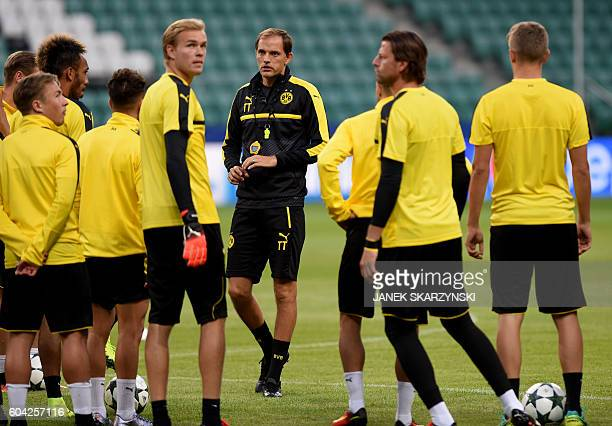 Thomas Tuchel head coach of Borussia Dortmund oversees a training session of his players at Legia stadium in Warsaw on September 13 2016 on the eve...