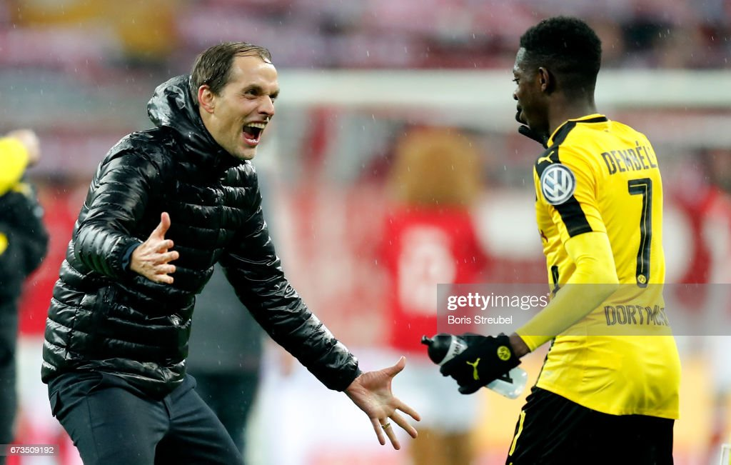 Thomas Tuchel, head coach of Dortmund celebrate victory with Ousmane Dembele after the DFB Cup semi final match between FC Bayern Muenchen and Borussia Dortmund at Allianz Arena on April 26, 2017 in Munich, Germany.