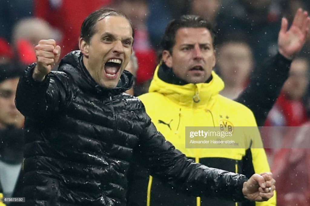 Thomas Tuchel, head coach of Dortmund celebrates after winning the DFB Cup semi final match between FC Bayern Muenchen and Borussia Dortmund at Allianz Arena on April 26, 2017 in Munich, Germany.