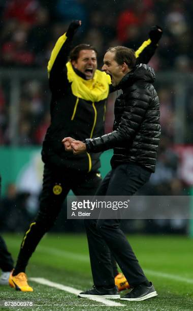 Thomas Tuchel head coach of Dortmund celebrates victory after the DFB Cup semi final match between FC Bayern Muenchen and Borussia Dortmund at...