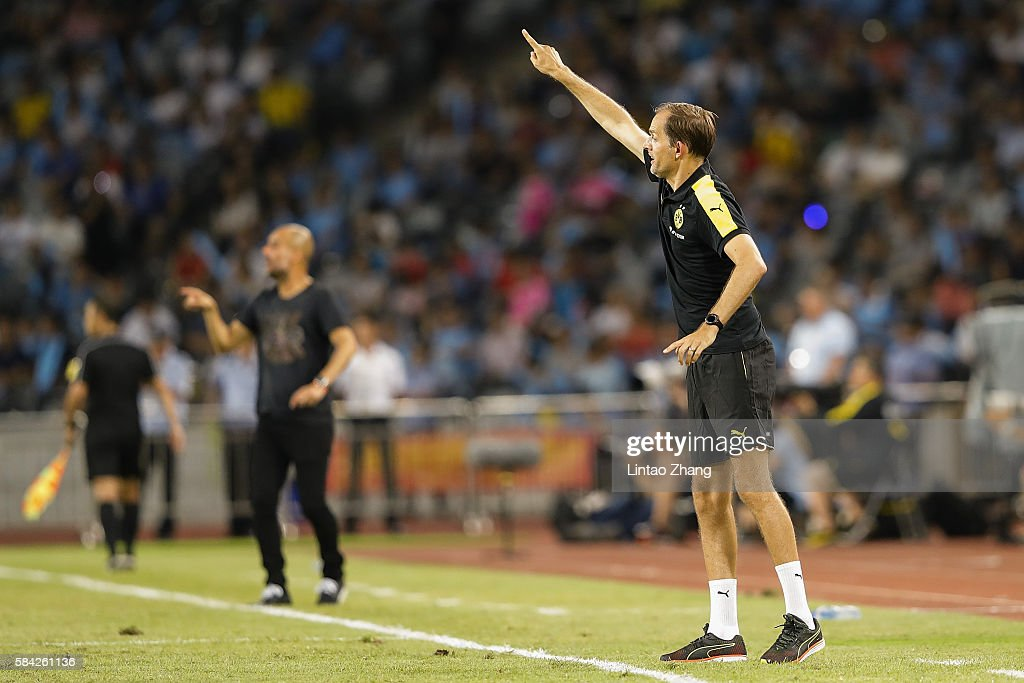 Thomas Tuchel, head coach of Dortmund gestures during the 2016 International Champions Cup match between Manchester City and Borussia Dortmund at Shenzhen Universiade Stadium on July 28, 2016 in Shenzhen, China.