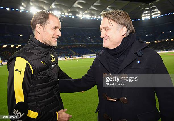 Thomas Tuchel, head coach of Dortmund shakes hands with Dietmar Beiersdorfer of Hamburger SV during the Bundesliga match between Hamburger SV and...