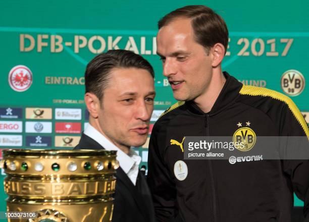 Thomas Tuchel head coach of German Bundesliga soccer club Borussia Dortmund and his Eintracht Frankfurt counterpart Niko Kovac seen after a press...