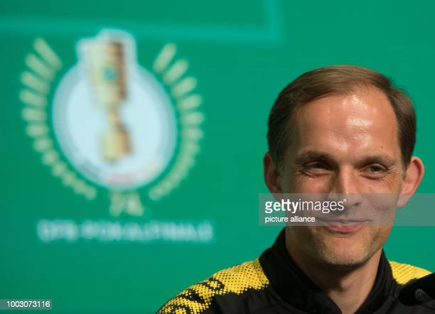 Thomas Tuchel head coach of German Bundesliga soccer club Borussia Dortmund smiles as he attends a press conference on theGerman DFBCup final at...