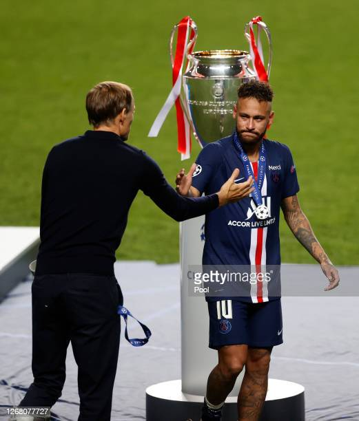 Thomas Tuchel, Head Coach of Paris Saint-Germain consoles Neymar of Paris Saint-Germain following Paris Saint-Germain's defeat in the UEFA Champions...