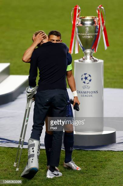 Thomas Tuchel, Head Coach of Paris Saint-Germain consoles Thiago Silva of Paris Saint-Germain following their team's defeat in the UEFA Champions...