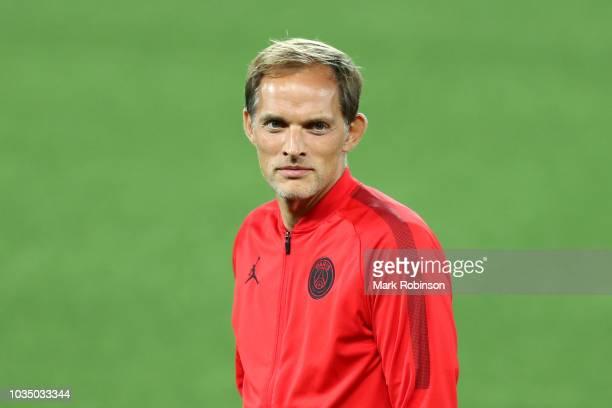 Thomas Tuchel Head Coach of Paris SaintGermain looks on as Paris SaintGermain walks the pitch on the eve of their UEFA Champions League Match against...