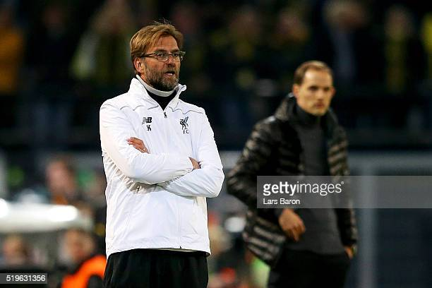 Thomas Tuchel manager of Borussia Dortmund and Jurgen Klopp manager of Liverpool look on from the touchline during the UEFA Europa League quarter...