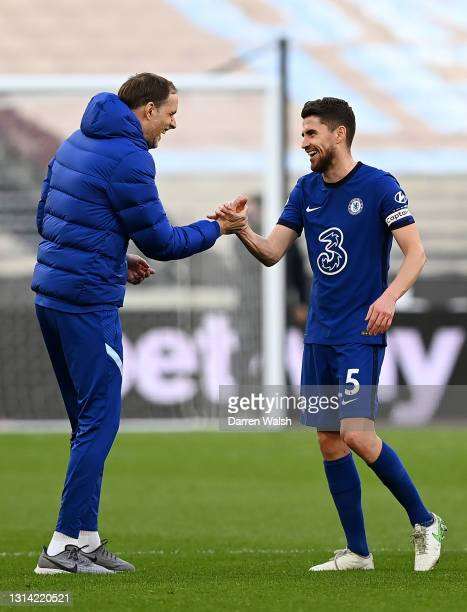 Thomas Tuchel, Manager of Chelsea and Jorginho of Chelsea interact following the Premier League match between West Ham United and Chelsea at London...