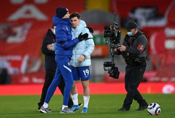 Thomas Tuchel, Manager of Chelsea and Mason Mount of Chelsea celebrate following their team's victory in the Premier League match between Liverpool...