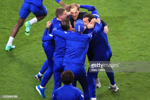 Thomas Tuchel, Manager of Chelsea celebrates with his staff following their team's victory in during the UEFA Champions League Final between...