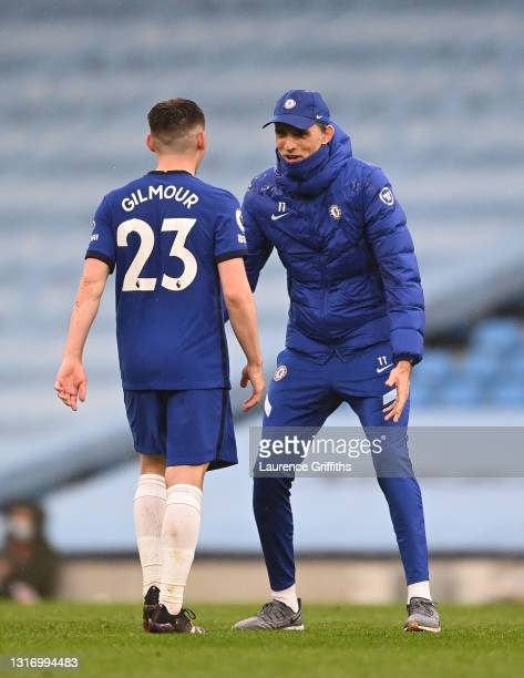 Thomas Tuchel, Manager of Chelsea embraces Billy Gilmour of Chelsea following the Premier League match between Manchester City and Chelsea at Etihad...