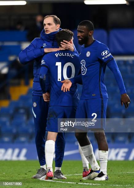 Thomas Tuchel, Manager of Chelsea embraces Christian Pulisic of Chelsea as team mate Antonio Rudiger looks on following the Premier League match...