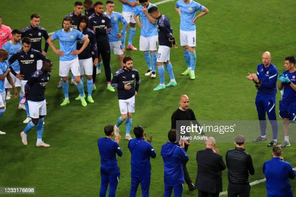 Thomas Tuchel, Manager of Chelsea greets Pep Guardiola, Manager of Manchester City as Chelsea give Manchester City a guard of honour following...