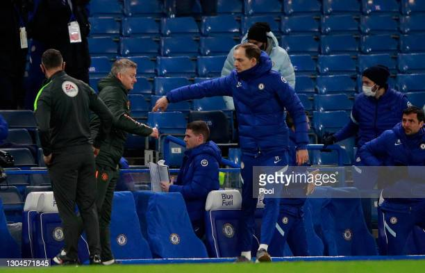 Thomas Tuchel, Manager of Chelsea interacts with Ole Gunnar Solskjaer, Manager of Manchester United following the Premier League match between...