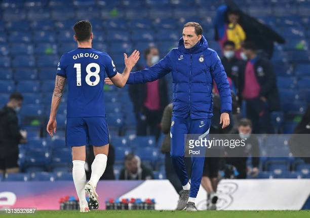 Thomas Tuchel, Manager of Chelsea interacts with Olivier Giroud after the Premier League match between Chelsea and Brighton & Hove Albion at Stamford...
