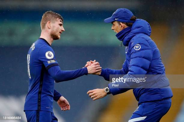 Thomas Tuchel, Manager of Chelsea interacts with Timo Werner of Chelsea after the Premier League match between Manchester City and Chelsea at Etihad...