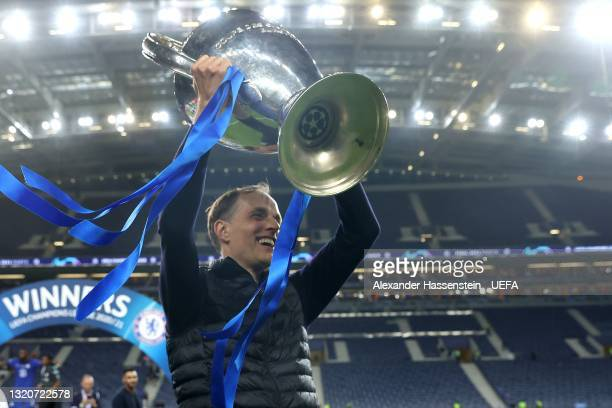 Thomas Tuchel, Manager of Chelsea lifts up the Champions League Trophy following their team's victory in the UEFA Champions League Final between...