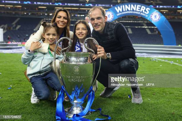 Thomas Tuchel, Manager of Chelsea poses with family and the Champions League Trophy following their team's victory in the UEFA Champions League Final...
