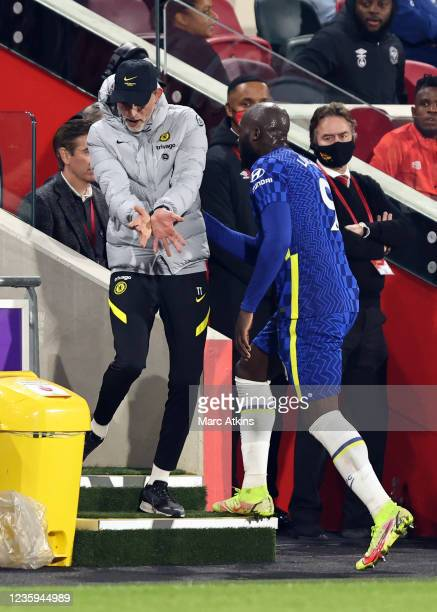 Thomas Tuchel manager of Chelsea reacts as Romelu Lukaku walks to the substitutes bench during the Premier League match between Brentford and Chelsea...