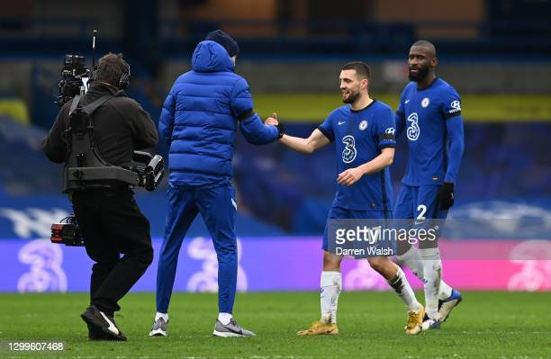 Thomas Tuchel, Manager of Chelsea shakes hands with Mateo Kovacic of Chelsea after the Premier League match between Chelsea and Burnley at Stamford...