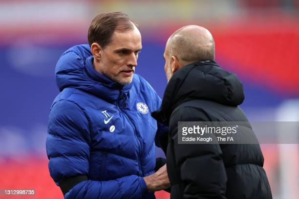 Thomas Tuchel, Manager of Chelsea shakes hands with Pep Guardiola, Manager of Manchester City following the Semi Final of the Emirates FA Cup match...