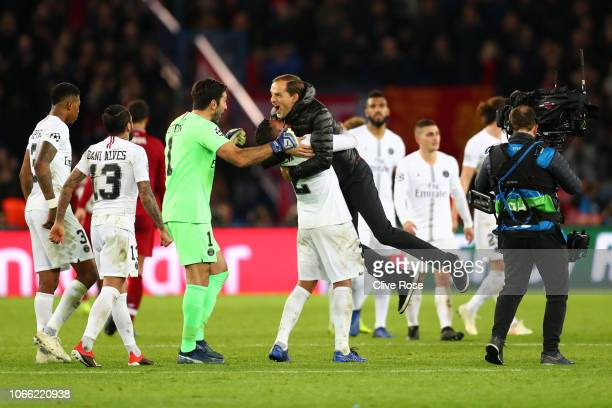 Thomas Tuchel Manager of Paris SaintGermain celebrates victory with Thiago Silva and Gianluigi Buffon of Paris SaintGermain following the UEFA...