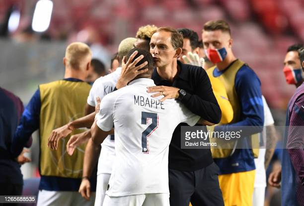 Thomas Tuchel, Manager of Paris Saint-Germain embraces Kylian Mbappe of Paris Saint-Germain after the UEFA Champions League Quarter Final match...