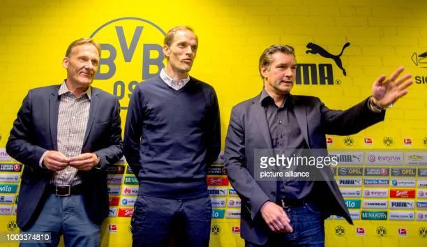 FILE Thomas Tuchel new coach of Bundesliga soccer club Borussia Dortmund sports director Michael Zorc and CEO HansJoachim Watzke photographed during...