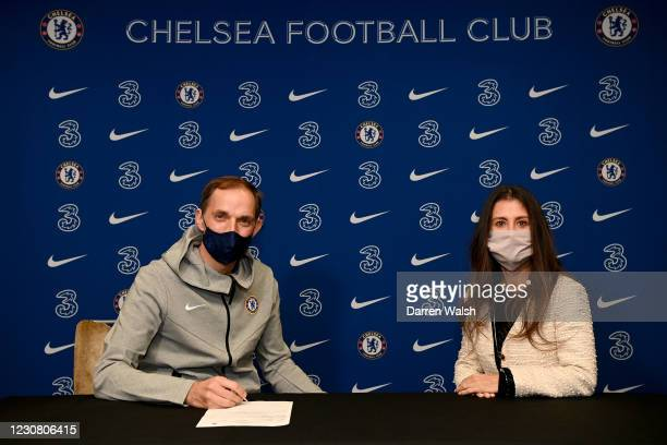 Thomas Tuchel of Chelsea signs his contract in the presence of Chelsea director Marina Granovskaia at Stamford Bridge on January 26, 2021 in London,...