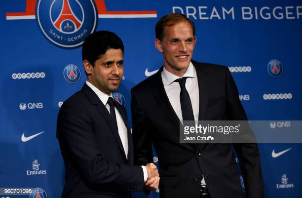 Thomas Tuchel of Germany is presented by President of PSG Nasser Al Khelaifi as new coach of Paris SaintGermain during a press conference at Parc des...