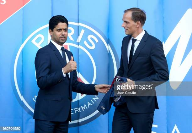Thomas Tuchel of Germany is presented by President of PSG Nasser Al Khelaifi as new coach of Paris SaintGermain at Parc des Princes stadium on May 20...