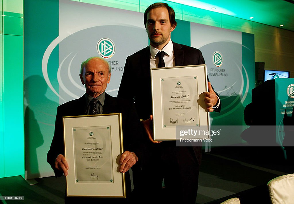 Thomas Tuchel (R) receives the Football Trainer of the year 2010 award and Dettmar Cramer (L) gets a honorary award at the hotel Wasserturm on March 17, 2011 in Cologne, Germany.
