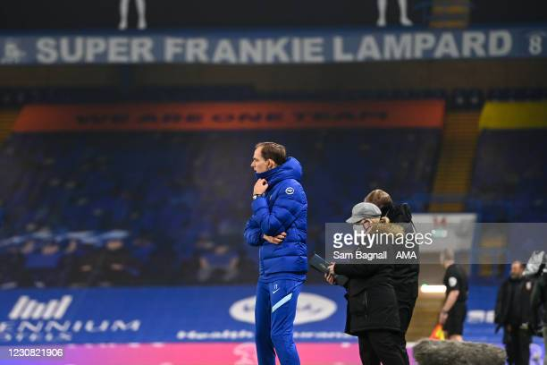 Thomas Tuchel the head coach / manager of Chelsea looks on with a banner for former head coach / manager Frank Lampard above him during the Premier...