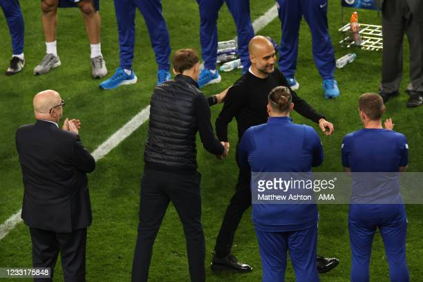 Thomas Tuchel the head coach / manager of Chelsea shakes hands with Pep Guardiola the manager / head coach of Manchester City during the UEFA...