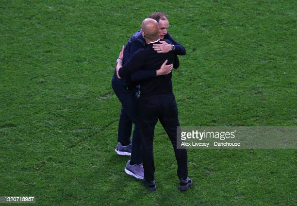 Thomas Tuchel the manager of Chelsea FC and Pep Guardiola the manager of Manchester City embrace after the UEFA Champions League Final between...