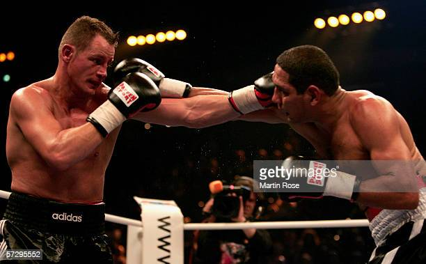 Thomas Ulrich of Germany and Henry Saenz of Nicaragua seen in action during the light heavyweight championship fight between Thomas Ulrich of Germany...