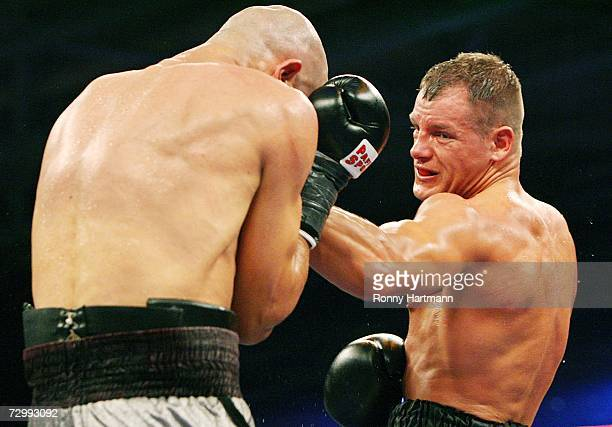 Thomas Ulrich of Germany punches Rachid Kanfouah of France during the vacant EBU and WBO Intercontinental Light Heavyweight title fight at the...