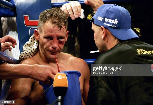 Thomas Ulrich of Germany spits blood during the WBO Light Heavyweight Title fight against Zolt Erdei of Hungary at the KoenigPilsener Arena on July...