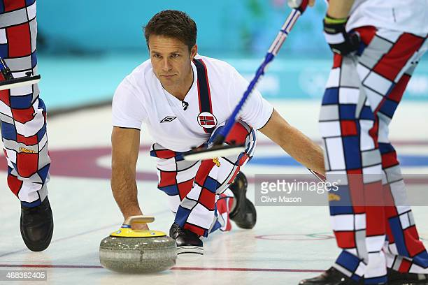 Thomas Ulsrud of Norway in action during the round robin match against USA during day 3 of the Sochi 2014 Winter Olympics at Ice Cube Curling Center...
