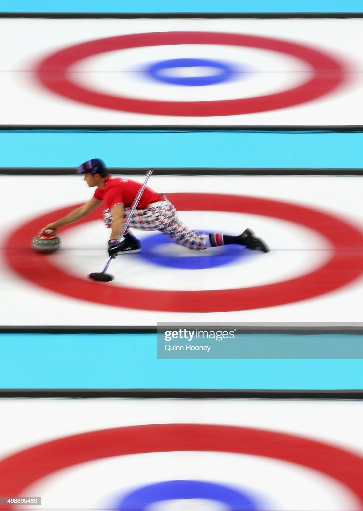 Thomas Ulsrud of Norway slides with the stone during Curling Men's Round Robin match between Norway and Germany during day five of the Sochi 2014 Winter Olympics at Ice Cube Curling Center on February 12, 2014 in Sochi, Russia.