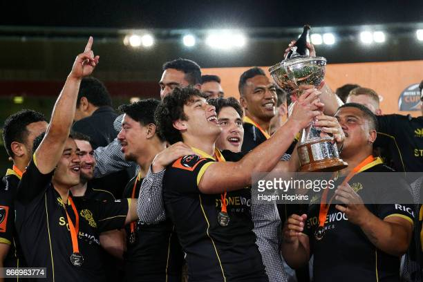 Thomas Umaga-Jensen of Wellington celebrates with the Championship Cup during the Mitre 10 Cup Championship Final match between Wellington and Bay of...