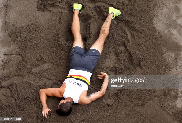 Thomas van der Plaetsen of Team Belgium is hurt while competing in the Men's Decathlon Long Jump on day twelve of the Tokyo 2020 Olympic Games at...