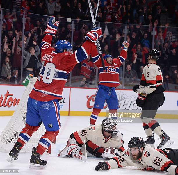 Thomas Vanek and Max Pacioretty of the Montreal Canadiens celebrate after the David Desharnais goal against the Ottawa Senators during the NHL game...