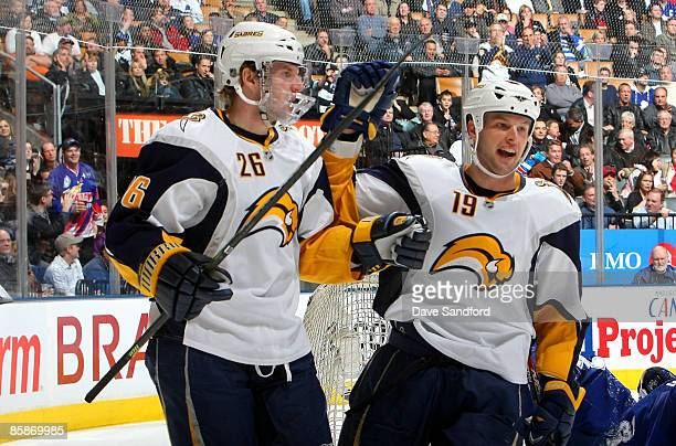 Thomas Vanek and Tim Connolly of the Buffalo Sabres celebrate Vanek's thirdperiod goal against the Toronto Maple Leafs in NHL action at the Air...