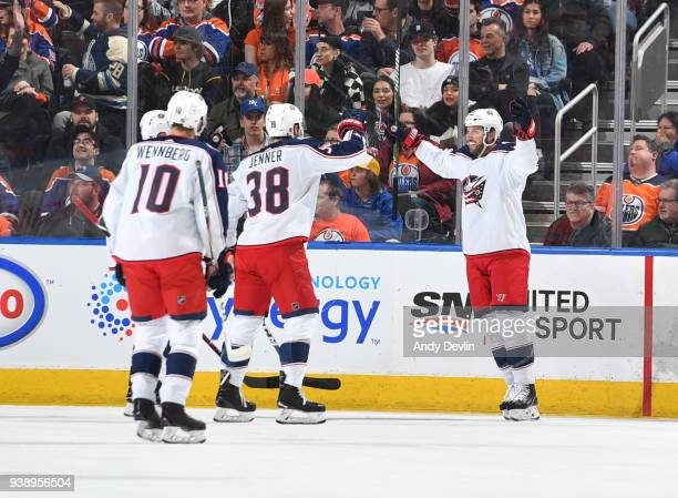 Thomas Vanek Boone Jenner and Alexander Wennberg of the Columbus Blue Jackets celebrate after a goal during the game against the Edmonton Oilers on...