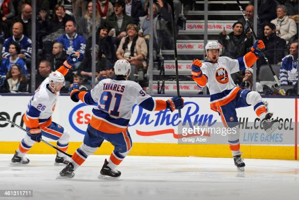 Thomas Vanek, John Tavares and Michael Grabner of the New York Islanders celebrate a second period goal during NHL game action against the Toronto...