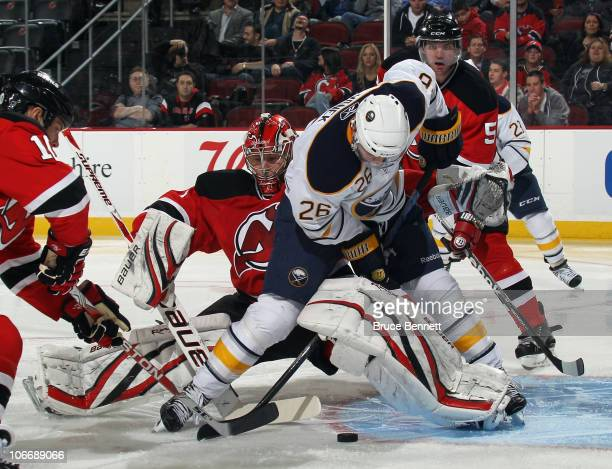 Thomas Vanek of the Buffalo Sabres attempts to get the puck past Johan Hedberg of the New Jersey Devils at the Prudential Center on November 10, 2010...