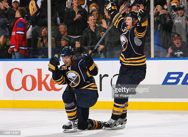 Thomas Vanek of the Buffalo Sabres celebrates his game-winning overtime goal with teammate Jordan Leopold for a 3-2 win over the Washington Capitals...