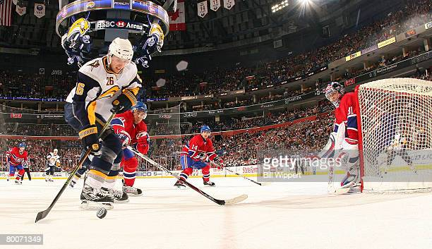 Thomas Vanek of the Buffalo Sabres controls the puck in front of Francis Bouillion and Carey Price of the Montreal Canadiens to set up a third period...